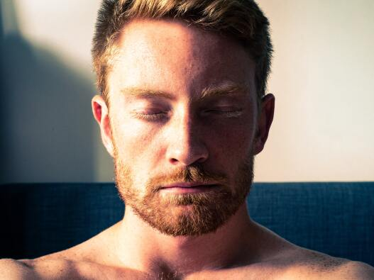 man practices box breathing with eyes closed for stress relief