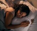 Woman sleeping peacefully after practicing PMR, progressive muscle relaxation