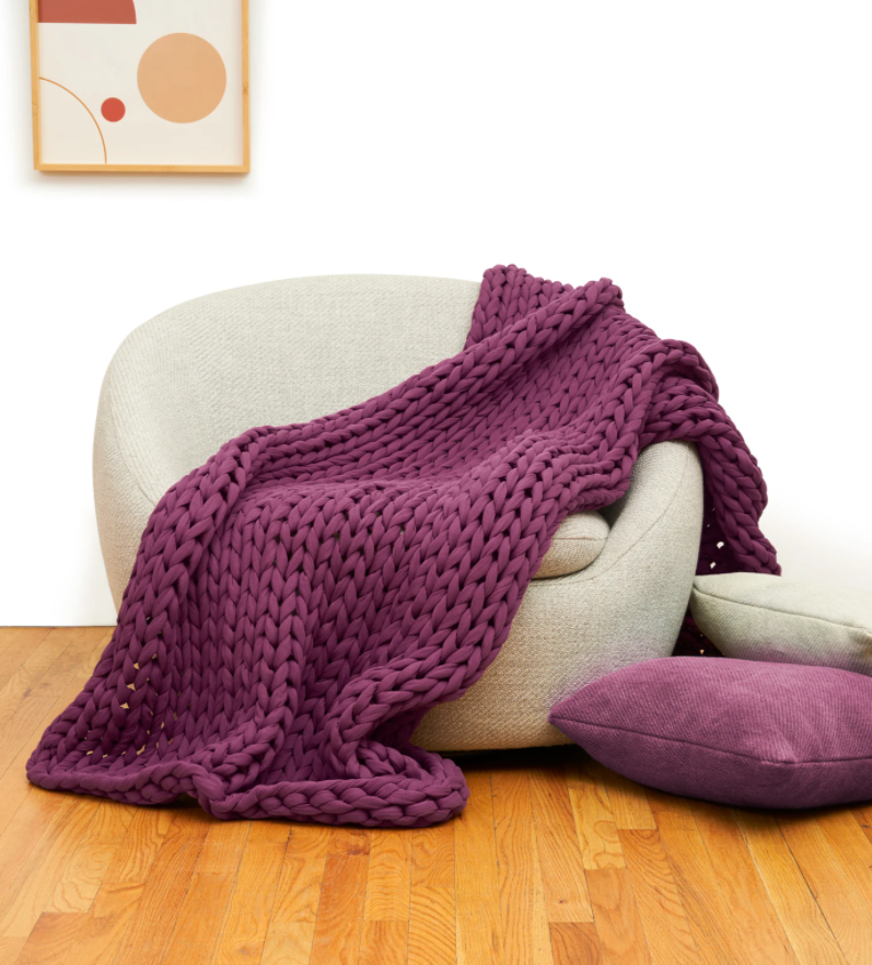 Bearaby Cotton Napper weighted blanket draped on a chair