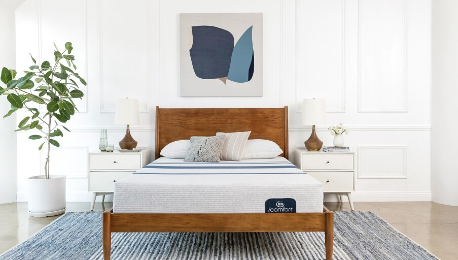 Serta icomfort mattress on a wooden bedframe in a bedroom