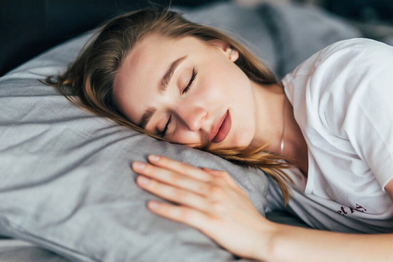 woman in bed sleep stages