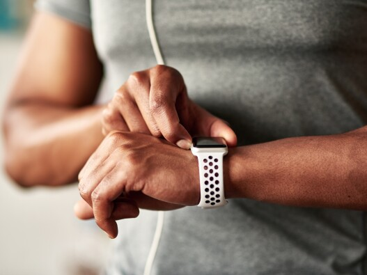 Close up of a smartwatch on a man's arm