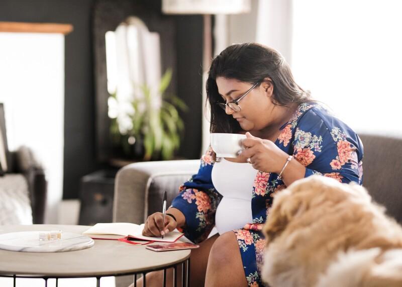 Woman writing in her morning sleep diary