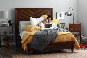 Couple in adjustable bed reading together