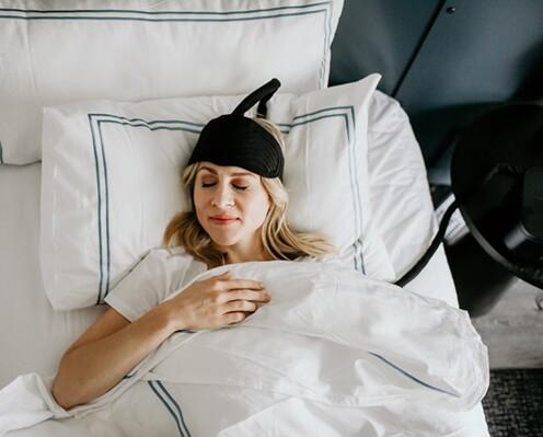woman sleeping wearing a cooling headband