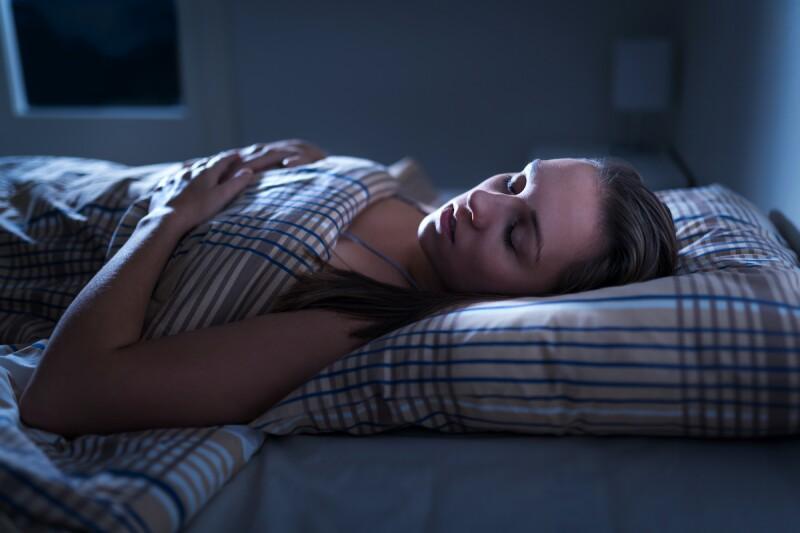 Person sleeping at night after taking melatonin