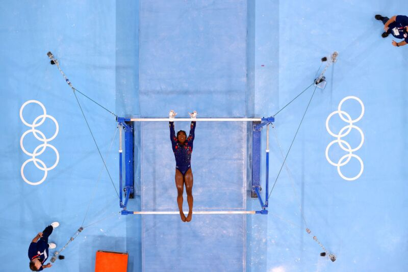 Simone Biles of Team United States competes on uneven bars during Women's Qualification of the Tokyo 2020 Olympic Games
