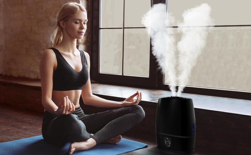 Woman meditating next to an Everlasting Comfort Cool Mist Humidifier