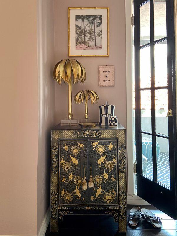Glam bedside decor in this Hollywood Regency inspired bedroom.