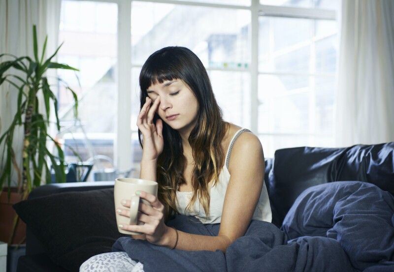 Woman experiencing daytime fatigue and needing a nap after a night of experiencing sleep apnea