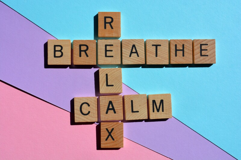 Scrabble tiles that say breathe, calm, and relax