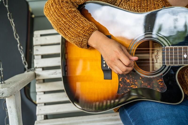 jackie venson strumming a guitar