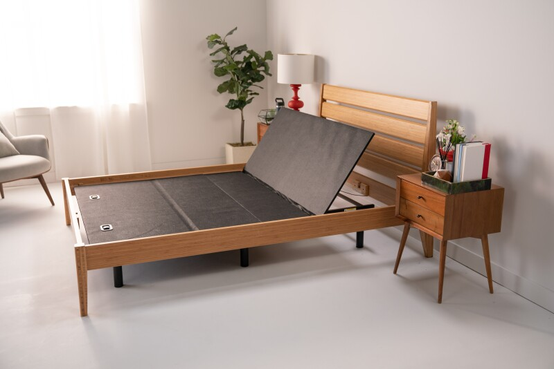 Adjustable bed base with wooden frame