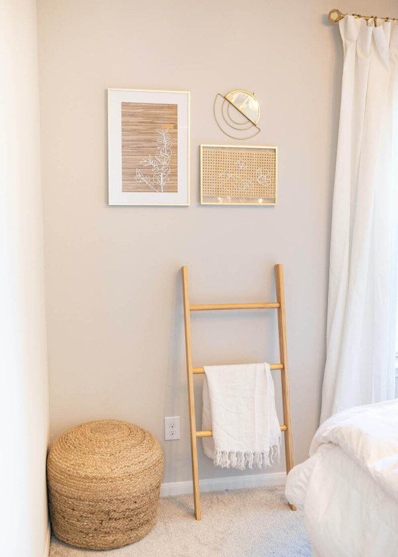 Guest bedroom ideas: A blanket, storage container, and wall art.
