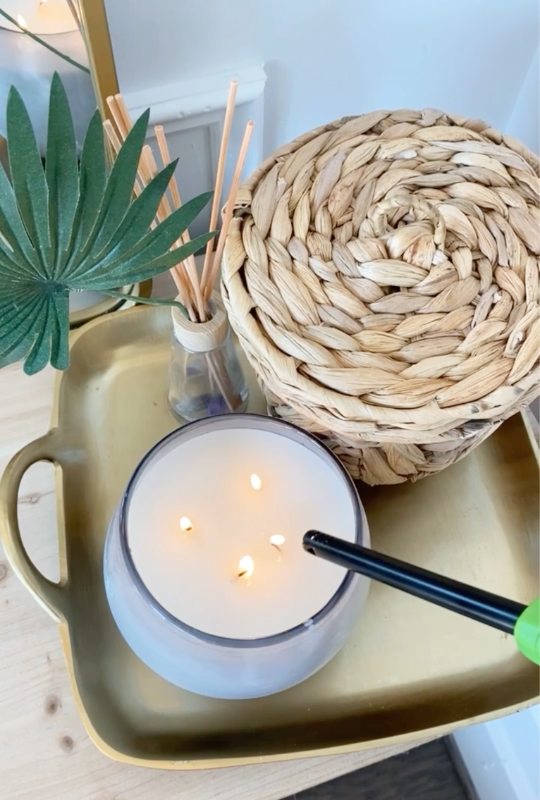 Tech Tuckaway Nightstand Decor: A candle, basket, and essential oils