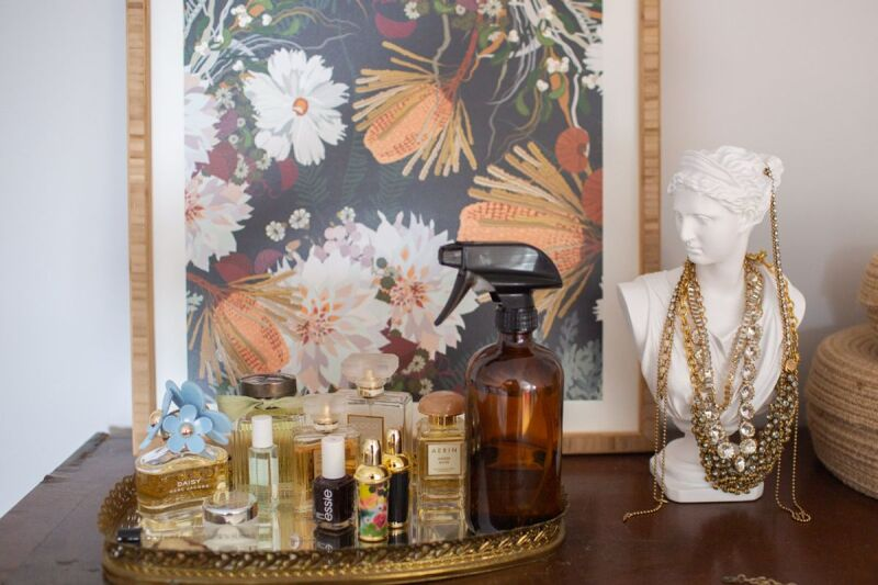 Bedside table with DIY linen spray for better sleep and rest.