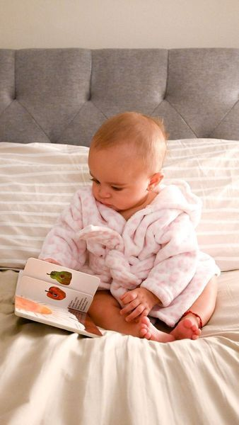 A child reading Spanish stories before bed.