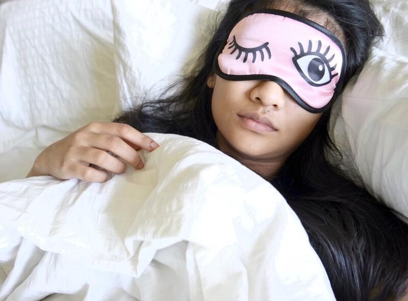 Woman in bed wearing an eyemask