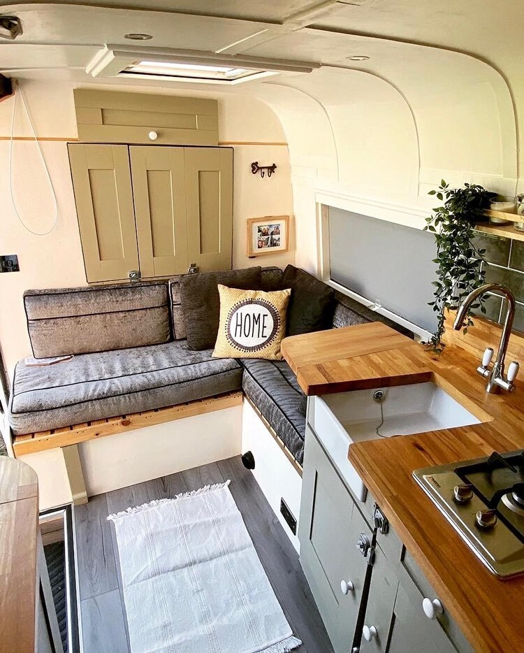 Camper van bed next to kitchen.