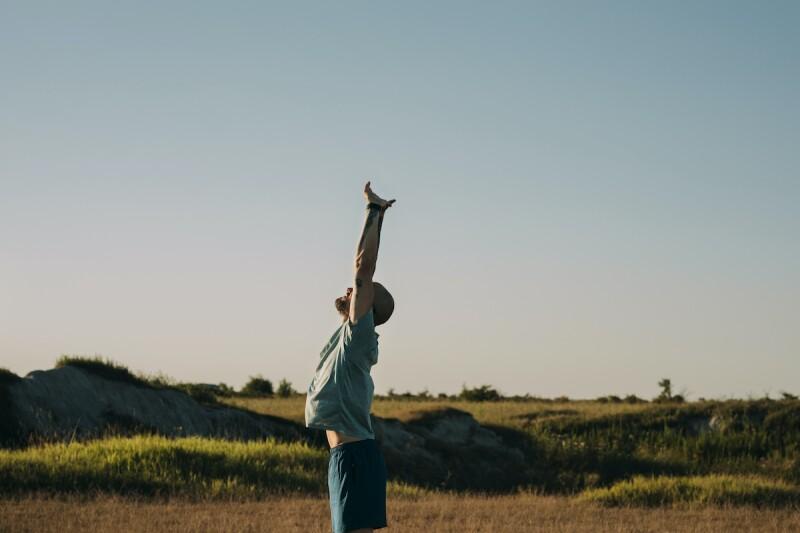 Man in sportswear stretching before a run in nature