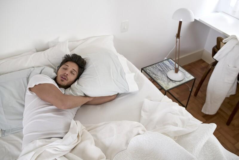 man sleeping on pillows