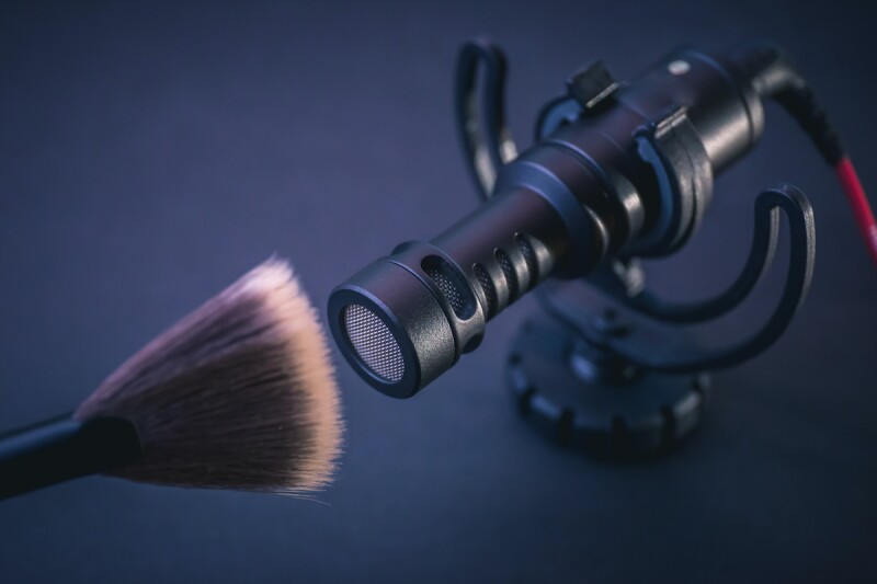 Makeup brush close to microphone for ASMR video