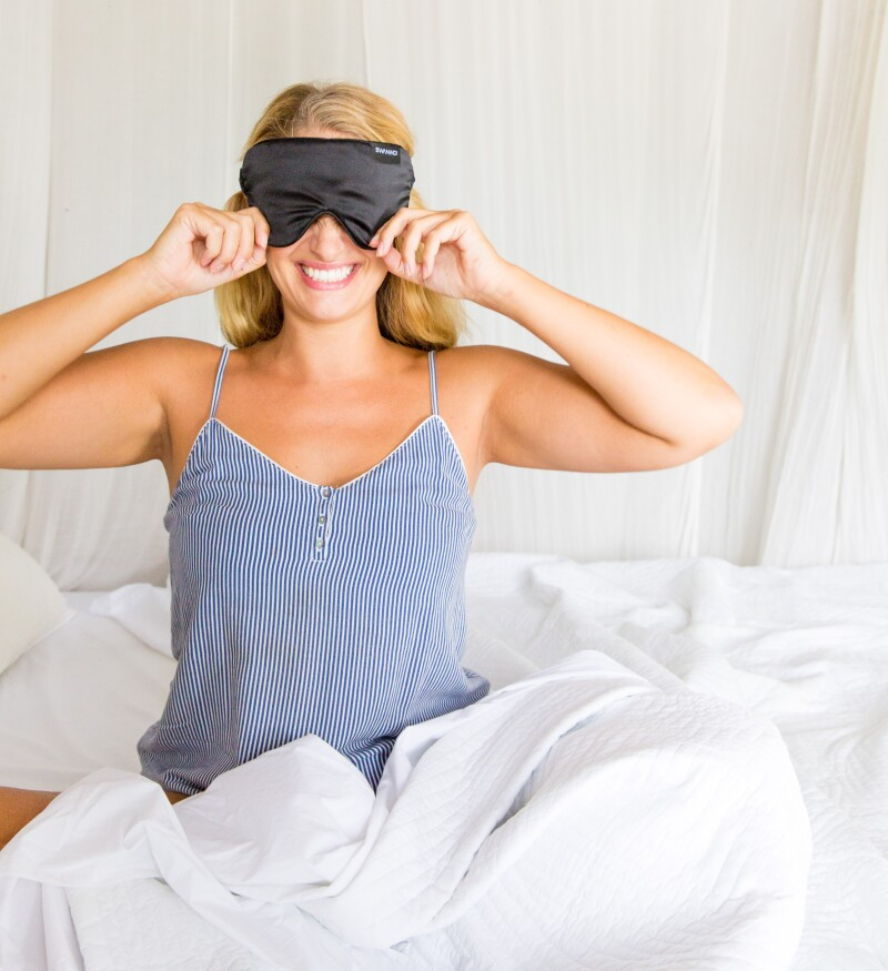 woman wearing black silk sleep mask