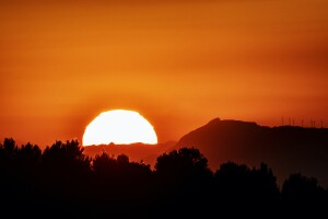 A very orange sunset, influenced by climate change