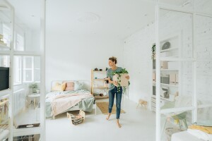 Girl moving into a new bedroom after graduating college