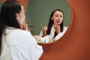 Woman applying beauty sleep cream.