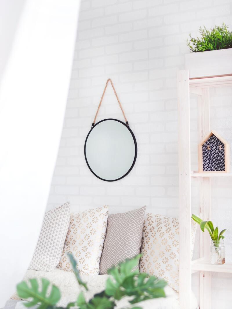 round-black-framed-mirror-on-the-wall-905198.jpg