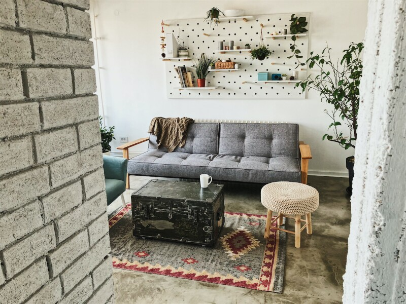 Small apartment with minimalistic, functional furniture for storage