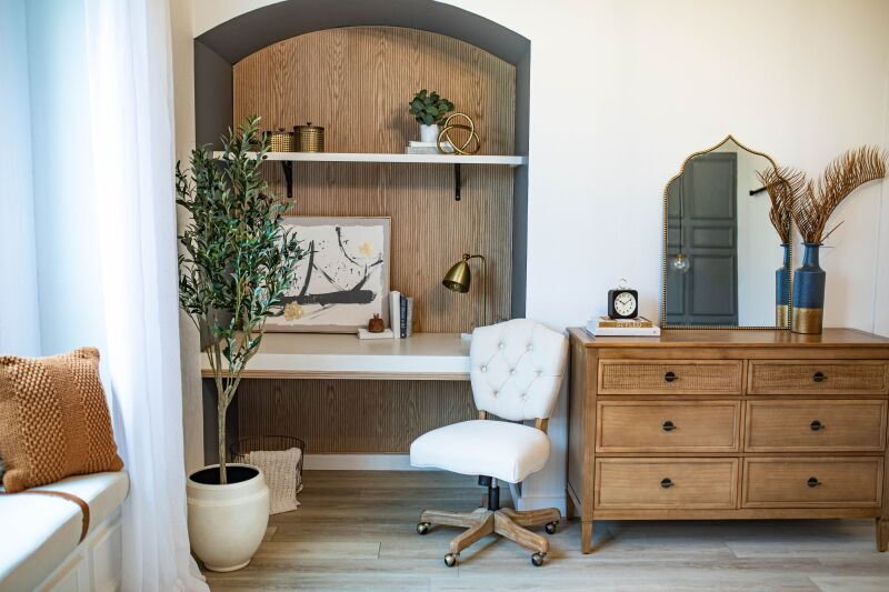 An arched desk nook with minimal decorations.