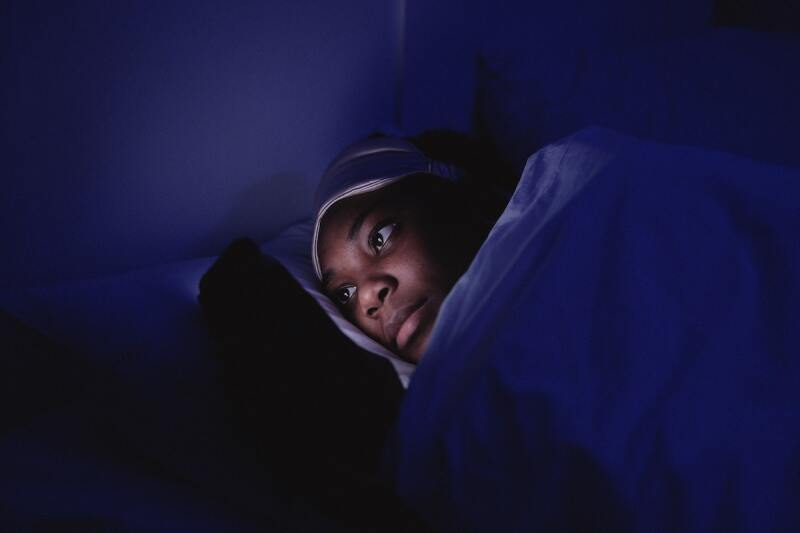 Person looking at their phone at night