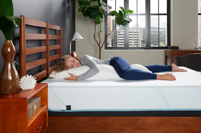 Woman using a Tempur-Pedic Body Pillow in bed