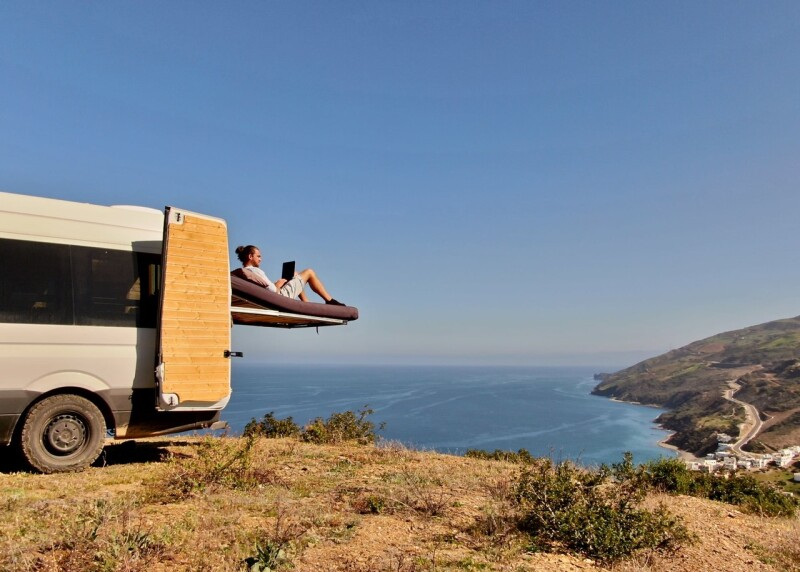 Camper van bed overlooking the ocean.