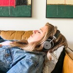 Girl laying on couch listening to binaural beats for sleep