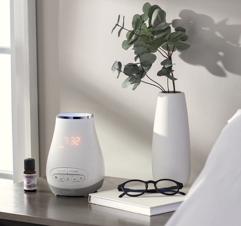 Homedics aromatherapy alarm clock on a nightstand