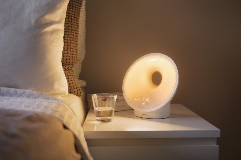 Philips SmartSleep Connected Sleep and Wake-Up Light on a nighstand.