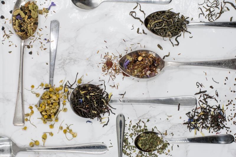 Various types of loose leaf tea in spoons