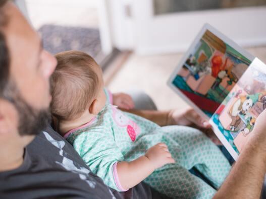 Man Reading to Child