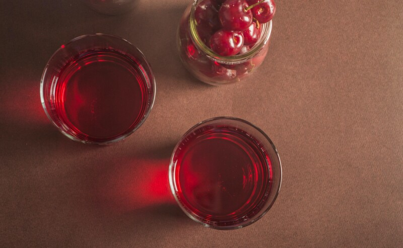 Bird's eye view of cherry juice in glasses, for better sleep